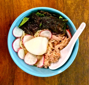 This variation of David Chang's ramen has a broth of chicken stock, pork, bacon dashi, and shiitakes. It uses Chang's recipe for shredded pork shoulder and the wickedly inventive slow poached eggs. It has mustard greens and radishes as well.