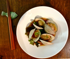 Littleneck clams with red miso broth, mustard greens, peas, and scallions.