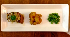 Beef filet topped with bacon, shiitakes, and pecorino; red miso glazed potatoes; and peas with watercress.