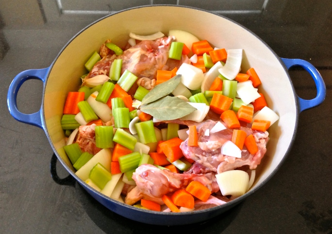 For the stock, I used mirepoix, the carcasses of the two deboned chickens with the wings and necks, two unpeeled garlic cloves, two bay leaves, and about eight black peppercorns. After adding 3 quarts of water and bringing to a boil, I simmered the stock for an hour and a half before removing the meat from the bones and putting the bones back in the stock. I simmered for 5 more hours, skimming the foam regularly.