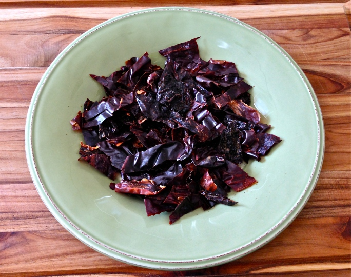 Dried chilies are in abundance in Houston grocery stores. For my chili paste, I use a mix of 2 New Mexico chilies, 2 ancho chilies, and 2 chipoltes. They are seeded, sliced, and cooked in 1 1/2 cups of water until they are soft enough to blend.