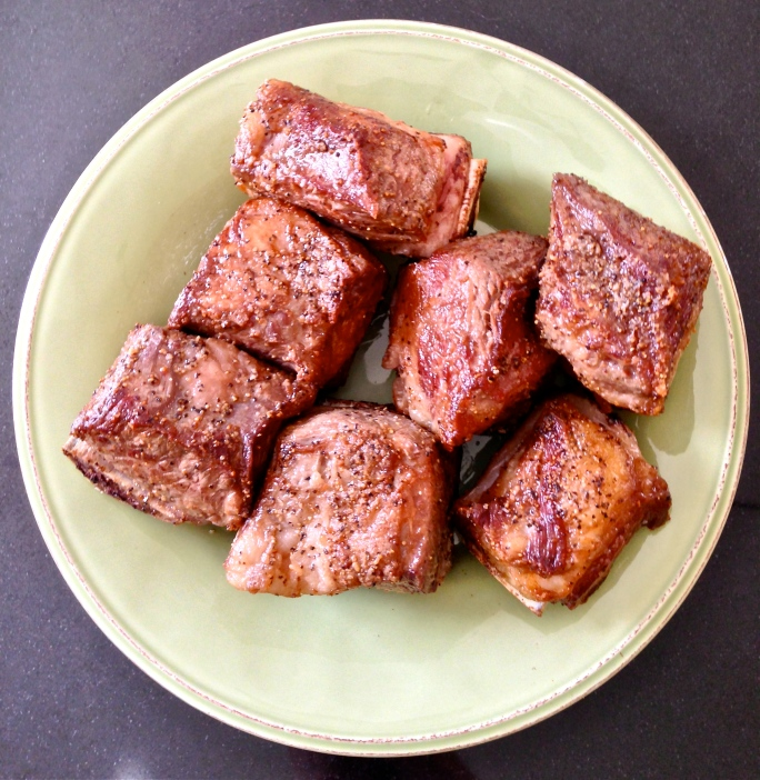 The short ribs are seasoned with kosher salt and cracked black pepper and browned in bacon fat. In the past, I have cooked off bacon in the dutch oven I use for the chili, reserving the bacon to garnish the chili. This time, the bacon became breakfast.