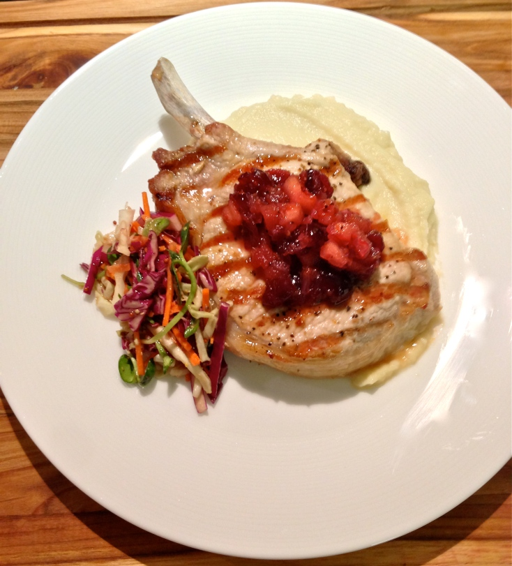 A thick French-cut pork chop with a blood orange-apple-cranberry chutney; sunflower sprout coleslaw; and a rutabaga-celery root-bleu cheese purée.