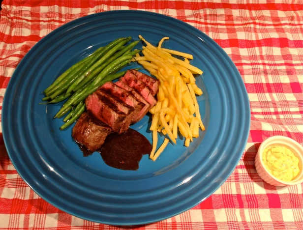 A simple and delicious steak frites with hand-cut french fries cooked in duck fat, steamed haricot vert, a blueberry and port pan sauce, and roasted garlic-thyme aioli.