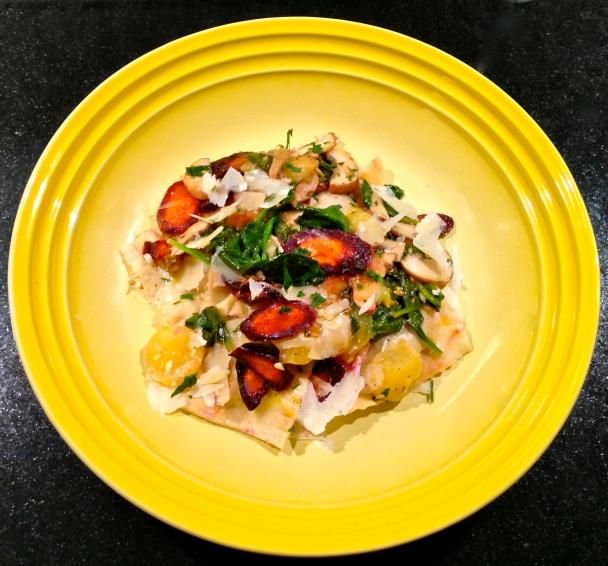 Potato, leek, chorizo, and truffled pecorino ravioli with sautéed mushrooms, spinach, yellow tomatoes, and roasted purple carrots in a white wine butter sauce.