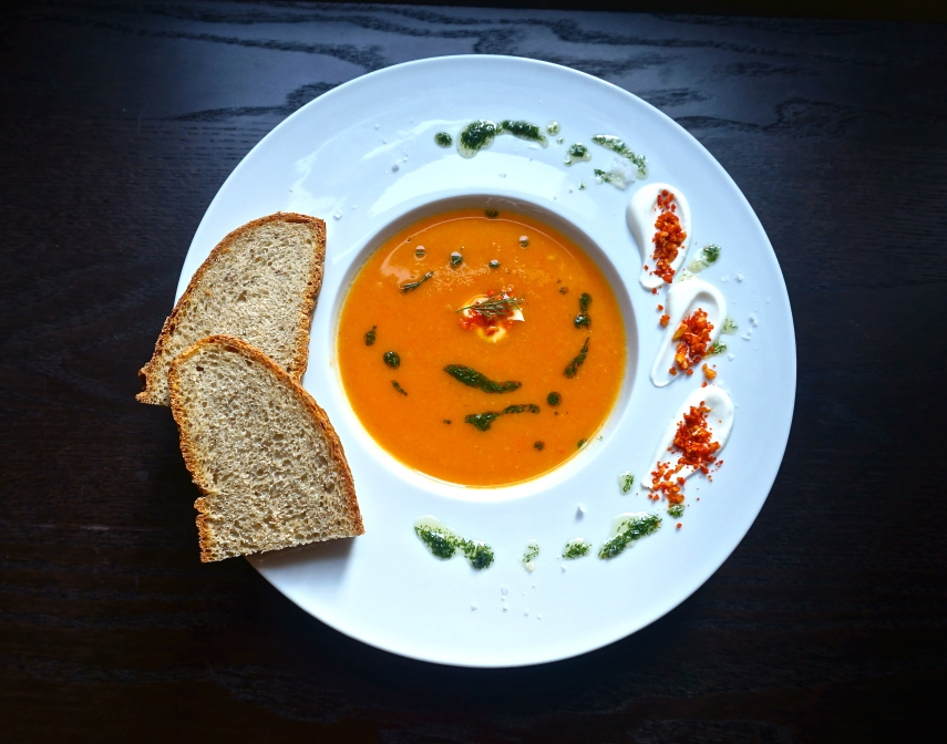Carrot and parsnip soup with garnishes of dill oil, smoked paprika seasoned crushed pine nuts, and a Greek yogurt-sour cream-lemon condiment. The bread is homemade rye, following the recipe from Smitten Kitchen.